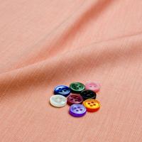 ボタンとオレンジ/ピンク 無地の生地