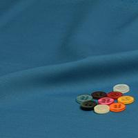 ボタンとグリーンブルー 無地の生地